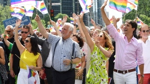 Prime Minister Justin Trudeau, right to left, wife Sophie Gregoire Trudeau, Quebec Premier Philippe Couillard and Montreal mayor Valerie Plante wave to the crowd as they march in the Pride Parade in Montreal on Sunday, Aug. 19, 2018. THE CANADIAN PRESS/Paul Chiasson