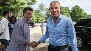 Michael Avenatti, right, an attorney and entrepreneur, arrives to speak at the Hillsborough County Democrats' Summer Picnic fundraiser in Greenfield, N.H. Sunday, Aug.19, 2018. Avenatti, the attorney taking on President Donald Trump over his alleged affair with an adult film actress, is exploring a possible 2020 run for president. (AP Photo/ Cheryl Senter)
