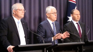 Australian Prime Minister Malcolm Turnbull, center, Treasurer Scott Morrison, left, and Environment Minister Josh Frydenberg address reporters at Parliament House in Canberra, Australia, Monday, Aug. 20, 2018. Turnbull abandoned plans to legislate to limit greenhouse gas emissions to head off a revolt by conservative lawmakers. Turnbull conceded that he could not get legislation through the House of Representatives where his conservative coalition holds only a single-seat majority. (AP Photo/Rod McGuirk)