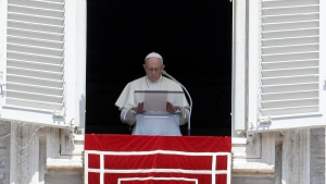 "FILE - In this Sunday, Aug. 19, 2018 file photo, Pope Francis prays for the victims of the Kerala floods during the Angelus noon prayer in St.Peter's Square, at the Vatican. Pope Francis has issued a letter to Catholics around the world condemning the ""crime"" of priestly sexual abuse and cover-up and demanding accountability, in response to new revelations in the United States of decades of misconduct by the Catholic Church. (AP Photo/Gregorio Borgia, File)"