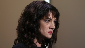 FILE - In this Saturday, May 19, 2018, file photo, actress Asia Argento speaks about being raped by Harvey Weinstein during the closing ceremony of the 71st international film festival, Cannes, southern France. The New York Times reports that Argento, one of the most prominent activists of the #MeToo movement, recently settled a lawsuit filed against her by a young actor and musician who said she sexually assaulted him when he was 17. (Photo by Vianney Le Caer/Invision/AP, File)