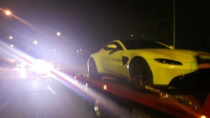 A 2019 Aston Martin is hauled away to an impound lot after York Regional Police caught its driver allegedly speeding through a school zone.