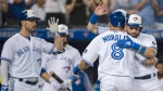 Toronto Blue Jays designated hitter Kendrys Morales (8) celebrates with centre fielder Kevin Pillar, right, and teammates after hitting a three run home run against the Baltimore Orioles during fifth inning AL baseball action in Toronto on Monday, August 20, 2018. THE CANADIAN PRESS/Nathan Denette
