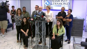 Attorney Darryl Singer is flanked by some of the plantiffs in a lawsuit against the Bombay Bhel restaurant in Mississauga. Six victims of a bombing at the restaurant are suing its owners for allegedly failing to take 'proactive steps' to boost security in order to protect customers.