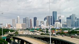 FILE - In this May 20, 2010, file photo, cars travel along a highway with the skyline of downtown Houston in the background. (Michael Paulsen/Houston Chronicle via AP, File)