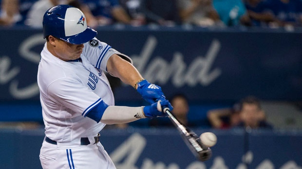 Toronto Blue Jays third baseman Aledmys Diaz (1) hits a solo home run against the Baltimore Orioles during second inning AL baseball action in Toronto on Tuesday, August 21, 2018. THE CANADIAN PRESS/Nathan Denette