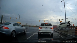 A dramatic crash on Highway 7 near Yonge Street is captured in this still image from a dashboard camera video.  (David Ursino)