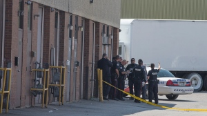 Police are seen outside an industrial area in Malvern on Aug. 24, 2018. (John Hanley)