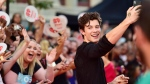 Shawn Mendes takes a selfie with fans as he arrives on the red carpet at the iHeartRadio MMVAs in Toronto on Sunday, Aug. 26, 2018. THE CANADIAN PRESS/Frank Gunn
