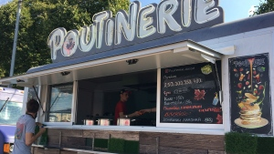 """Owners Masha Klimova and Alexey Kolesov's """"Poutinerie"""" food truck is being prepared for the day at the Faces & Laces Festival in Gorky Park, Moscow, Russia, Saturday August 18, 2018. THE CANADIAN PRESS/Melanie Marquis"""