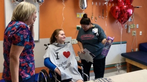 Tiffany Kleinschmidt (centre) of Waterford, Mich. is shown in a Children's Hospital of Michigan handout photo. For one 15-year-old fan who's attending Taylor Swift's Tuesday night show with the help of a nurse from Quebec, it would have been impossible to sing along with her favourite artist just a few months ago. THE CANADIAN PRESS/HO-Children's Hospital of Michigan