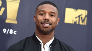 "In this June 16, 2018 file photo, Michael B. Jordan arrives at the MTV Movie and TV Awards in Santa Monica, Calif. Jordan was in Montgomery, Ala., on Monday, Aug. 27, to begin filming ""Just Mercy,"" which is based on the memoir of attorney and criminal justice advocate Bryan Stevenson. He made an impromptu visit with some students from Valiant Cross Academy who were exercising in the midday heat. (Photo by Jordan Strauss/Invision/AP, File)"