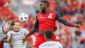 Toronto FC's Jozy Altidore goes battles for the ball against Chicago Fire during the first half of MLS soccer action in Toronto, Saturday July 28, 2018. THE CANADIAN PRESS/Mark Blinch