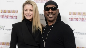 "In this Nov. 20, 2016, file photo, Paige Butcher, left, and Eddie Murphy attend ""SUBCONSCIOUS"" by Bria Murphy Gallery Opening at Lace Gallery in Los Angeles. (Photo by Richard Shotwell/Invision/AP, File)"