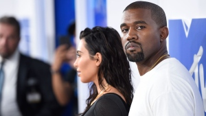 "In this Aug. 28, 2016 file photo, Kim Kardashian West, left, and Kanye West arrive at the MTV Video Music Awards in New York. Kanye West has apologized on a Chicago radio station for suggesting slavery was a ""choice."" (Photo by Evan Agostini/Invision/AP, File)"