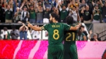 Portland Timbers' Diego Valeri (8) and Diego Chara (21) celebrate after Chara's second-half goal against Toronto FC during an MLS soccer match Wednesday, Aug. 29, 2018, in Portland, Ore. (Sean Meagher/The Oregonian via AP)