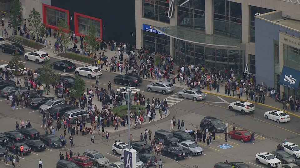 Shoppers flee Yorkdale Shopping Centre following a shooting on Thursday, Aug. 30, 2018.