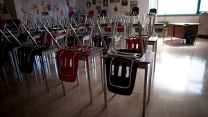 A vacant desksa are pictured at the front of a empty classroom is pictured at McGee Secondary school in Vancouver on Sept. 5, 2014. School districts in British Columbia are scrambling to hire an unprecedented number of teachers ahead of the new school year to adhere to reinstated class size standards. THE CANADIAN PRESS/Jonathan Hayward