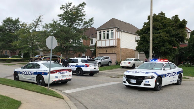 Police are seen investigating a fatal shooting in Brampton on Sunday in the area of Sunforest Drive and Sandalwood Parkway East.