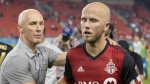 Los Angeles FC Head Coach Bob Bradley (left) consoles his son Toronto FC captain Michael Bradley after Los Angeles 4-2 win in MLS action in Toronto on Saturday September 1 , 2018. THE CANADIAN PRESS/Chris Young