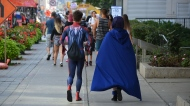 People walk dressed in costumes outside Fan Expo Canada at the Metro Toronto Convention Centre Sunday September 2, 2018. (Joshua Freeman /CP24)