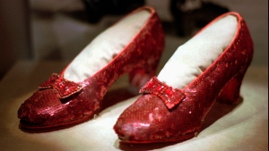 """FILE - This April 10, 1996, file photo shows one of the four pairs of ruby slippers worn by Judy Garland in the 1939 film """"The Wizard of Oz"""" on display during a media tour of the """"America's Smithsonian"""" traveling exhibition in Kansas City, Mo. Federal authorities say they have recovered a pair of ruby slippers worn by Garland that were stolen from the Judy Garland Museum in Grand Rapids, Minn., in August 2005 when someone went through a window and broke into the small display case. The shoes were insured for $1 million. (AP Photo/Ed Zurga, File)"""