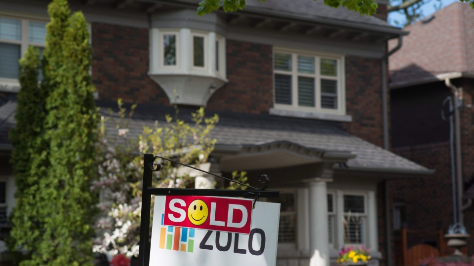A sold sign is shown in front of west-end Toronto homes Sunday, May 14, 2017. THE CANADIAN PRESS/Graeme Roy