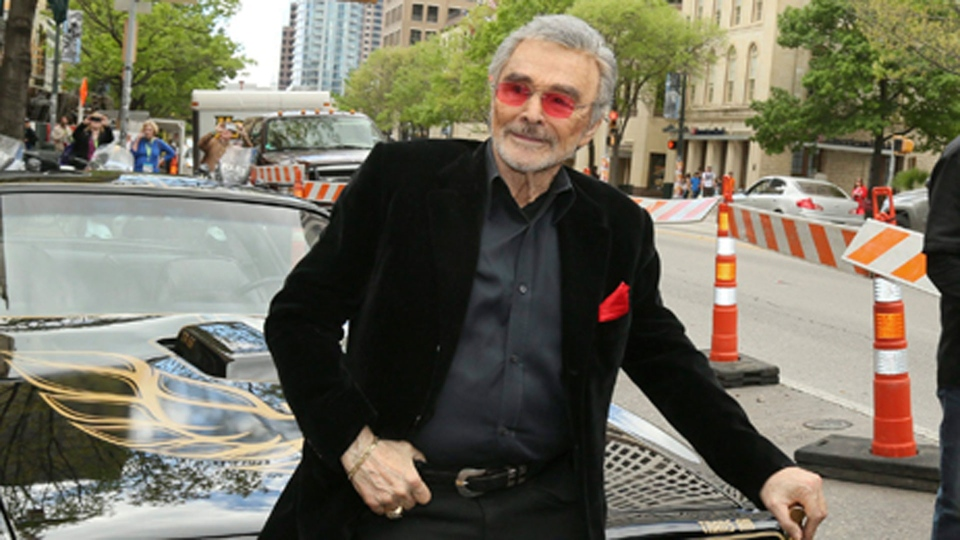 "In this March 12, 2016 file photo, Burt Reynolds sits on a 1977 Pontiac Trans-Am at the world premiere of ""The Bandit"" at the Paramount Theatre during the South by Southwest Film Festival in Austin, Texas.  (Photo by Jack Plunkett/Invision/AP)"