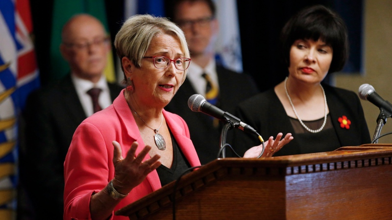 Judy Darcy, British Columbia Minister of Mental Health and Addictions responds to a reporter's question at a press conference during the Conference of Provincial-Territorial Ministers of Health in Winnipeg, Friday, June 29, 2018. THE CANADIAN PRESS/John Woods