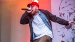 In this July 29, 2016 file photo, Mac Miller performs at Lollapalooza in Chicago. Miller, the platinum hip-hop star whose rhymes vacillated from party raps to lyrics about depression and drug use, has died at the age of 26. A family statement released through his publicists says Miller died Friday, Sept. 7, 2018, and there are no further details available on how he died. (Photo by Amy Harris/Invision/AP)