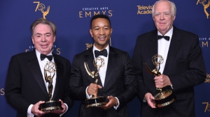 "Andrew Lloyd Webber, left, John Legend, and Tim Rice winners of the award for outstanding variety special for ""Jesus Christ Superstar Live in Concert"" poses in the press room during night two of the Creative Arts Emmy Awards at The Microsoft Theater on Sunday, Sept. 9, 2018, in Los Angeles. (Photo by Richard Shotwell/Invision/AP)"