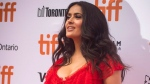 """Actress Salma Hayek poses for photos on the red carpet for the premiere of the film """"The Hummingbird Project"""" during the 2018 Toronto International Film Festival in Toronto on Saturday, September 8, 2018. THE CANADIAN PRESS/ Tijana Martin"""