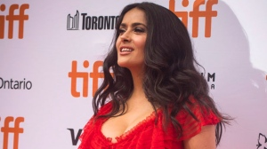 "Actress Salma Hayek poses for photos on the red carpet for the premiere of the film ""The Hummingbird Project"" during the 2018 Toronto International Film Festival in Toronto on Saturday, September 8, 2018. THE CANADIAN PRESS/ Tijana Martin"