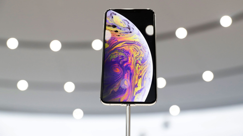 The new Apple iPhone XS Max is on display at the Steve Jobs Theater after an event to announce new products Wednesday, Sept. 12, 2018, in Cupertino, Calif. (AP Photo/Marcio Jose Sanchez)