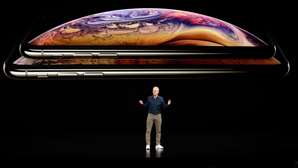 Apple CEO Tim Cook discusses the new iPhone XS and iPhone XS Max at the Steve Jobs Theater during an event to announce new products Wednesday, Sept. 12, 2018, in Cupertino, Calif. (AP Photo/Marcio Jose Sanchez)