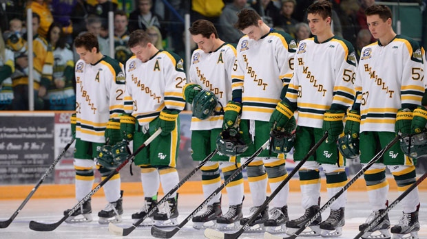 Returning Humboldt Broncos players Brayden Camrud (26) and Derek Patter (23), far left, along with other teammates take part in moment of silence during a pregame ceremony before playing the Nipawin Hawks in the SJHL season home opener Wednesday, Sept. 12, 2018. The Humboldt Broncos are playing their first game since a bus crash claimed 16 lives in April. THE CANADIAN PRESS/Jonathan Hayward