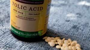 A bottle of folic acid is photographed, Wednesday, May 11, 2016, in New York.It's been known for years that taking folic acid before and during pregnancy can prevent neural tube defects like spina bifida in newborns. But research suggests the B vitamin also appears to lower the risk of some potentially fatal congenital heart defects in children. THE CANADIAN PRESS/AP-/Mary Altaffer