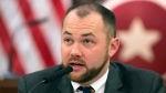 In this Nov. 10, 2014 file photo, New York City Councilman Corey Johnson speaks at a hearing in introducing legislation making it easier for transgender people to change the sex on their birth certificates. (AP Photo/Mark Lennihan File)