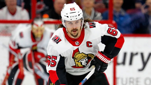 In this Jan. 30, 2018, file photo, Ottawa Senators' Erik Karlsson (65) moves the puck against the Carolina Hurricanes during the first period of an NHL hockey game in Raleigh, N.C. The San Jose Sharks have acquired two-time Norris Trophy-winning defenseman Erik Karlsson from the Senators, the teams announced Thursday, Sept. 13, 2018. (AP Photo/Karl B DeBlaker, File)