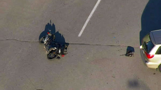 Police are investigating a collision between a motorcycle and a van in Richmond Hill.