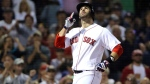 Boston Red Sox's J.D. Martinez celebrates his solo home run as he crosses the plate in the second inning of a baseball game against the Toronto Blue Jays at Fenway Park, Thursday, Sept. 13, 2018, in Boston. (AP Photo/Elise Amendola)