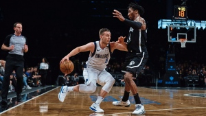 Dallas Mavericks' Kyle Collinsworth (8) drives to the basket against Brooklyn Nets' Rondae Hollis-Jefferson, right, during the first half of an NBA basketball game, Saturday, March 17, 2018, in New York. (AP Photo/Andres Kudacki)