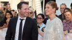 "Director Matthew Heineman and actor Rosamund Pike attend a red carpet for the movie "" A Private War"" during the 2018 Toronto International Film Festival in Toronto on Friday, September 14, 2018. THE CANADIAN PRESS/Fred Thornhill"