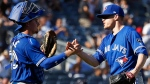Toronto Blue Jays' Ken Giles celebrates with catcher Reese McGuire after defeating the New York Yankees in a baseball game on Sunday, Sept. 16, 2018, in New York. (AP Photo/Adam Hunger)