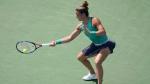 Maria Sakkari, of Greece, returns to Naomi Osaka, of Japan, at the Western & Southern Open, Tuesday, Aug. 14, 2018, in Mason, Ohio. (AP Photo/John Minchillo)
