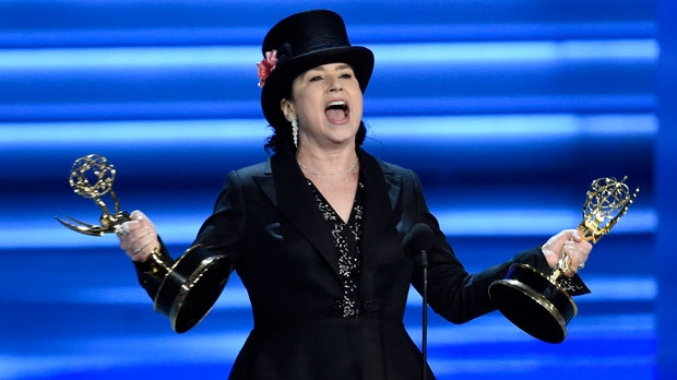 "Amy Sherman-Palladino accepts the award for outstanding directing for a comedy series for ""The Marvelous Mrs. Maisel"" at the 70th Primetime Emmy Awards on Monday, Sept. 17, 2018, at the Microsoft Theater in Los Angeles. (Photo by Chris Pizzello/Invision/AP)"
