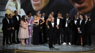 "Lorne Michaels, center, and the cast and crew from ""Saturday Night Live"" accept the award for outstanding variety sketch series at the 70th Primetime Emmy Awards on Monday, Sept. 17, 2018, at the Microsoft Theater in Los Angeles. (Photo by Chris Pizzello/Invision/AP)"