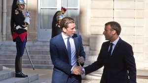 French President Emmanuel Macron, left, welcomes Austrian Chancellor Sebastian Kurz at the Elysee Palace in Paris, France, Monday, Sept. 17, 2018. Austrian Chancellor Sebastian Kurz is in Paris to discuss the informel European Summit in Salzburg next Thursday Sept. 20, 2018. (AP Photo/Michel Euler, Pool)