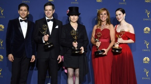 "Michael Zegen, from left, Daniel Palladino, Amy Sherman-Palladino, Sheila Lawrence, Rachel Brosnahan pose in the press room with the award for outstanding comedy series for ""The Marvelous Mrs. Maisel"" at the 70th Primetime Emmy Awards on Monday, Sept. 17, 2018, at the Microsoft Theater in Los Angeles. (Photo by Jordan Strauss/Invision/AP)"