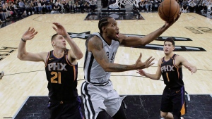 Kawhi Leonard is happy and healthy, says Toronto Raptors president Masai Ujiri. Leonard (2), then with San Antonio, scores as Phoenix Suns centre Alex Len (21) and guard Devin Booker (1) defend during first half NBA basketball action in San Antonio, Friday, Jan. 5, 2018. THE CANADIAN PRESS/AP-Eric Gay
